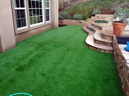 fake grass carpet bastrop texas landscape rock backyard