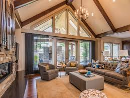 lighting a space with a vaulted ceiling light my nest a large chandelier adds a lot of light to the center of the room