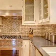 kitchen faucets seattle chicago backsplash tile home kitchen traditional with herringbone