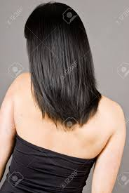 rear view of a woman with long straight black hair stock photo
