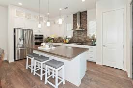 white cabinets with black countertops and backsplash 20 kitchen backsplash ideas for white cabinets