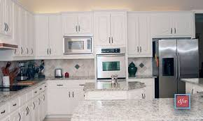 painting kitchen cabinets professionally cost light white refinished kitchen cabinets create a cheerful