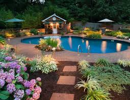 low voltage lighting near swimming pool pool area lighting can make your summer evenings even more magical