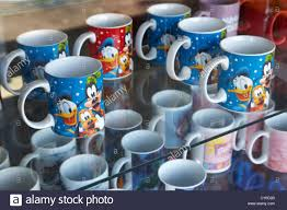disney character mugs for sale in a souvenir shop florida usa