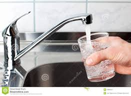 kitchen drinking water faucet glass filled with drinking water from kitchen faucet stock image