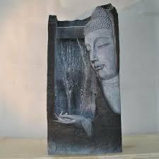 design zimmerbrunnen zimmerbrunnen mit buddha bringen sie wärme ins haus archzine net