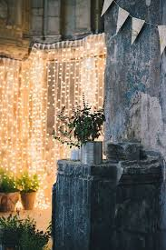 outdoor wall decor ideas with wood plants and lights rustic chic