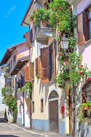 vertical oriented image of typical italian house with balcony