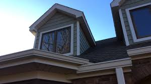home designer pro dormer vinyl shake siding installed on dormers in the color cypress with