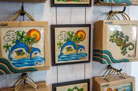 souvenirs gifts and art works made with natural sand sandart