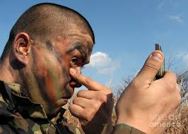 pinterest discover and save creative ideas a soldier applying face paint prior photograph by stocktrek images