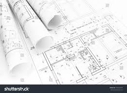 architects workspace rolled building plans blueprints stock photo