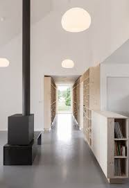 Home Clean by Country Home With Clean Lines Features Hallway Of Bookshelves
