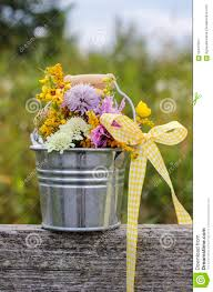 silver bucket with wild flowers stock photo image 52407564