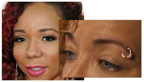 tiny color ti s wife tiny harris talks changing eye color with african surgery