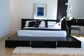 contemporary japanese style bedroom with black frame bed and white