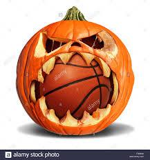 basketball autumn concept as a pumpkin jack o lantern biting into