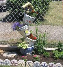 47 best tipsy pot planters images on pinterest garden ideas