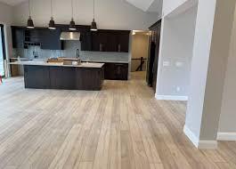 oak kitchen cabinets with oak flooring coretec floors our noble oak floors look stunning in