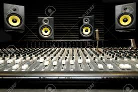 Recording Studio Mixing Desk by Low Angle Shot Of A Mixing Desk With Yellow And Black Speakers
