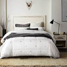 6 tips to choosing the best down comforter for your bed