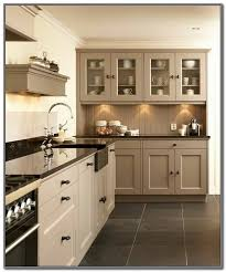 two tone kitchen cabinets with black countertops beige kitchen cabinets with black countertops