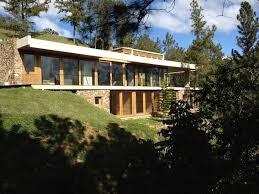 homes built into hillside vasho s green roofed and energy efficient rd house blends into a