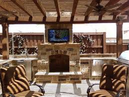 hidden outdoor tv mount on stone fireplace wall for backyard gazebo design jpg