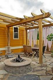 Patio Designs With Pergola by Backyard Patio Design With Pergola Fire Pit Area And Seating Wall