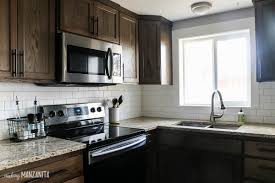 black kitchen cabinets with white subway tile backsplash how to install subway tile backsplash tutorial included