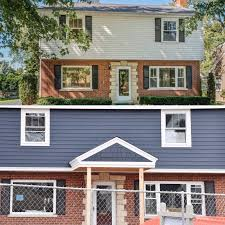 picking blue exterior siding with a red brick home home with keki
