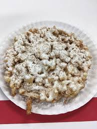 funnel cake with apple topping ice cream and whipped cream