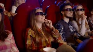 young people watch movies in cinema watch a comedy in 3d all