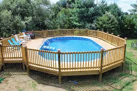 octagonal above ground swimming pool design with wooden deck