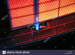Lighting A Pilot Light The Pilot Light On A Butane Gas Heater With The Red Fire Bricks