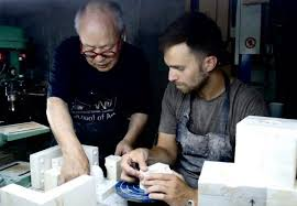 red house design studio jingdezhen ceramics graduate student assists porcelain artist yasuda in china