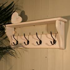 white distressed wooden wall mounted shelf with black wrought iron