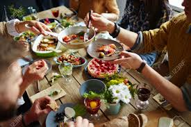 Dining Table With Food Sitting At Dining Table And Stock Photo Picture And