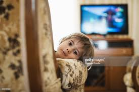 pics of a tv 2 years boy in front of a tv stock photo getty images