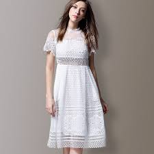 white lace dress with sleeves knee length white lace floral polka dots pattern sleeve knee