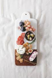 a custom monogram charcuterie board for fall entertaining from