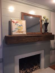 this fireplace transformation started with covering the out dated