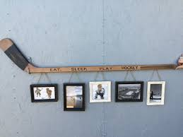 retro hockey stick with 5 hanging frames 110 sold out hockey