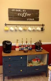 coffee bar we used the towel bar hooks and shelf above our buffet