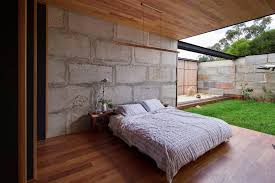 sawmill house built of reclaimed concrete blocks used by archier