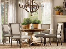 round dining room tables for 6 natural wooden round dining table with flowerspot and chandelier