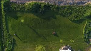 aerial lawn mower cutting grass in rural backyard 4k stock video