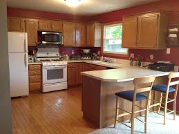 red brown kitchen designs with oak cabinets on beadboard floor