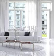 modern loft living room interior with monochromatic white decor