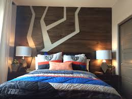 cool wood detail on back wall boy teen room snowboard themed
